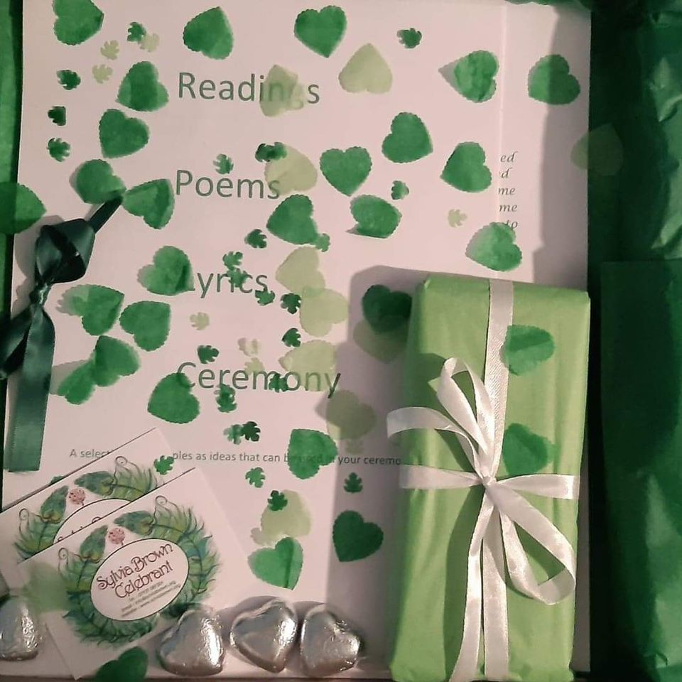 A picture of Sylvia's Client Welcome Pack. It's white and green, with green heart-shaped petals.