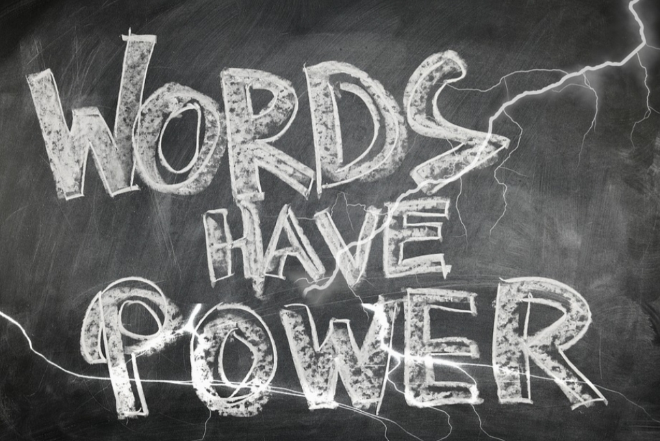 A picture of a blackboard with the phrase, Words Have Power, written in chalk.